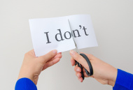 stock-photo-44668422-female-hand-cutting-paper-with-words-concept