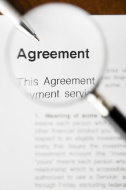 stock-photo-7421023-close-up-high-angle-view-magnifier-and-agreement
